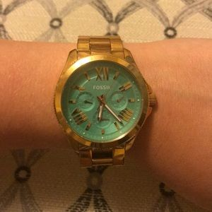FOSSIL gold watch with teal face